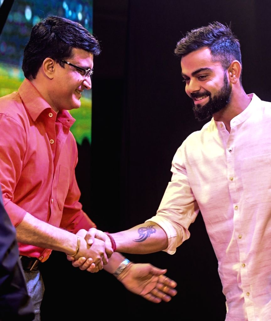 Indian cricket team's captain Virat Kohli and Cricket Association of Bengal (CAB) President Sourav Ganguly during the launch of Boria Majumdar's book 'Eleven Gods and a Billion Indians' in ... - Virat Kohli and Sourav Ganguly