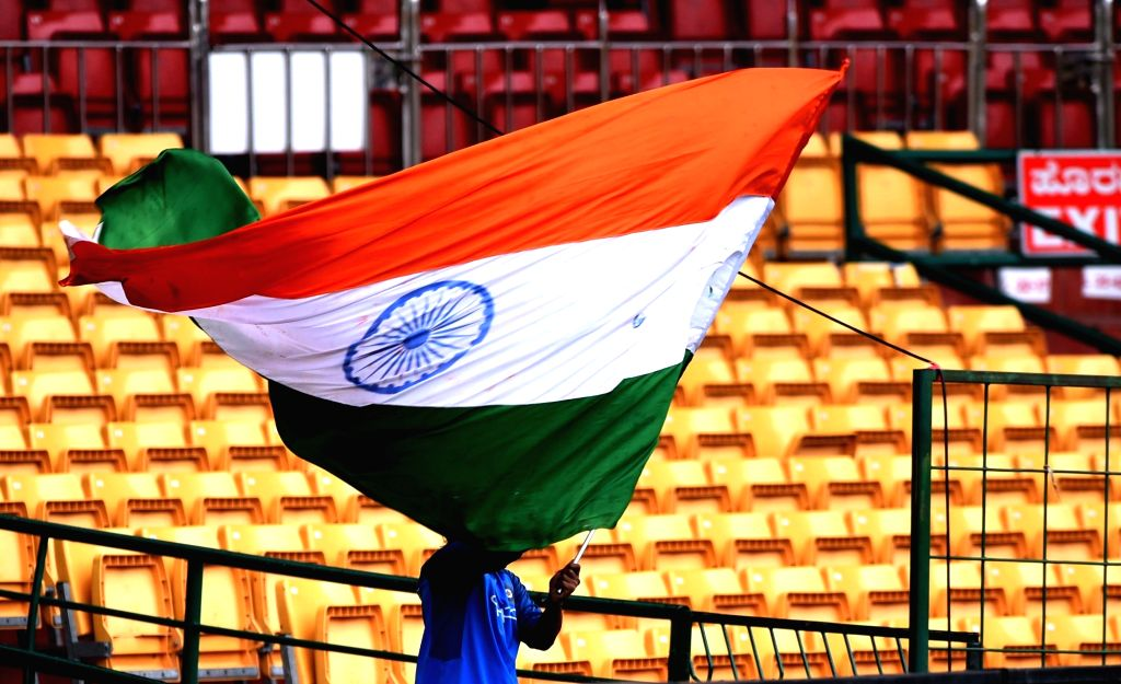 Indian cricket team's supporters with the national flag ahead of the 4th ODI between India and Australia at the M. Chinnaswamy Stadium in Bengaluru on Sept 27, 2017.