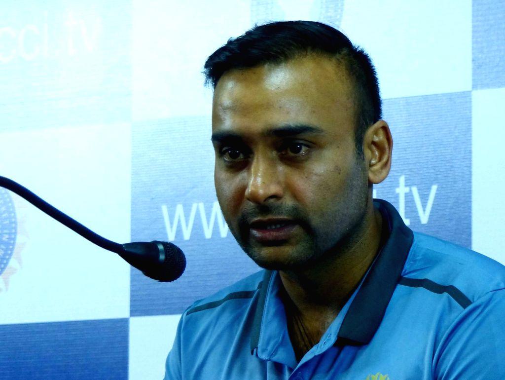 Indian cricketer Amit Mishra addresses a press conference at Chinnaswamy Stadium, in Bengaluru on July 2, 2016. - Amit Mishra