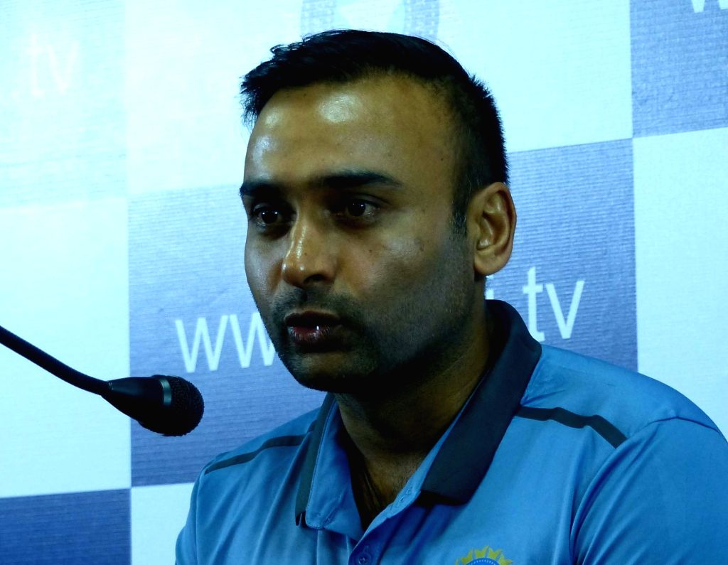 Indian cricketer Amit Mishra addresses a press conference at Chinnaswamy Stadium, in Bengaluru on July 2, 2016. - Amit Mishra