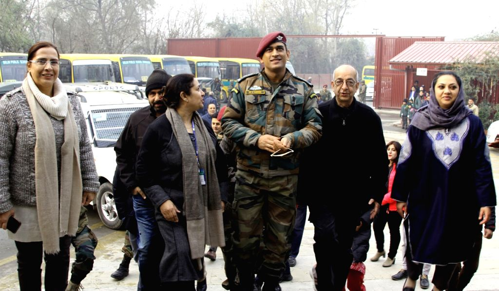 Indian cricketer and Lt Col (Hony) MS Dhoni during his visit to a school in Srinagar on Nov 28, 2017. - MS Dhoni