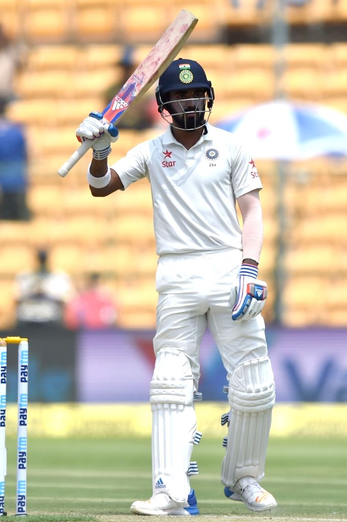 Indian cricketer Lokesh Rahul raises his bat after scoring half century during day one of the second test match between India and Australia at M Chinnaswamy Stadium in Bengaluru on March ... - Lokesh Rahul