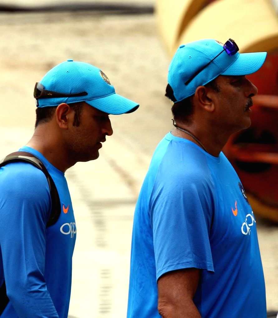 Indian cricketer MS Dhoni along with head coach Ravi Shastri during a practice session in Chennai on Sept 16, 2017. - MS Dhoni