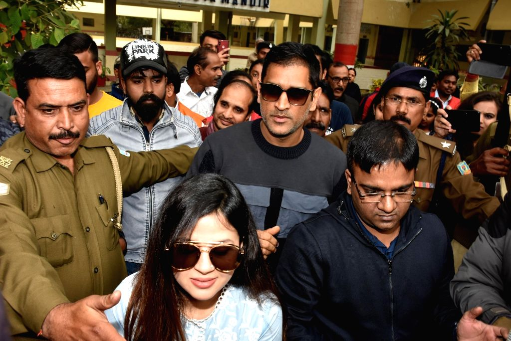 Indian cricketer MS Dhoni and his wife Sakshi Dhoni come out after casting their votes at Jawahar Vidya Mandir during the third phase of Jharkhand Assembly elections, in Ranchi on Dec 12, ... - MS Dhoni