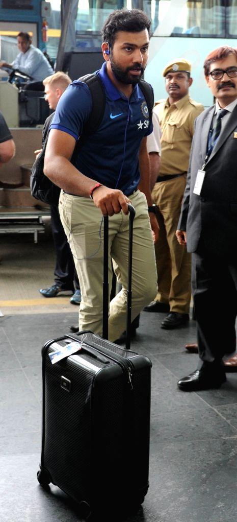 Indian cricketer Rohit Sharma departs from Netaji Subhas Chandra Bose International Airport in Kolkata on Oct 5, 2016. - Rohit Sharma