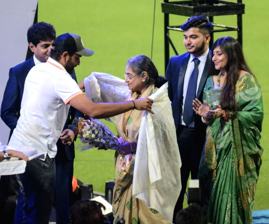 Indian cricketer Rohit Sharma felicitates wife of cricket administrator Jagmohan Dalmiya during Jagmohan Dalmiya Annual Conclave in Kolkata on Nov 2, 2018. - Rohit Sharma