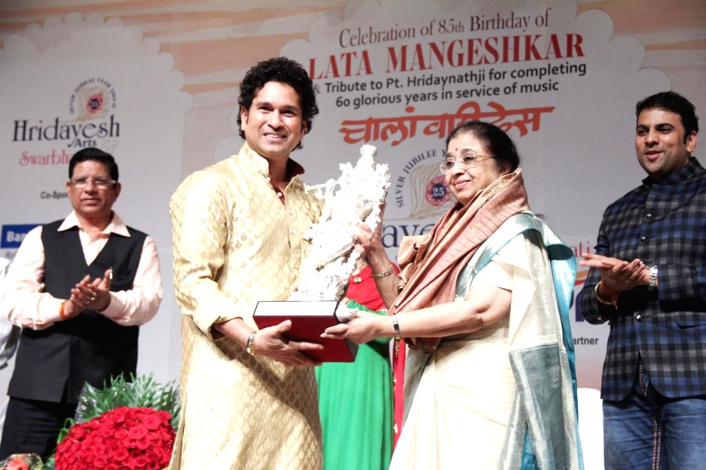 Indian cricketer Sachin Tendulkar felicitates singer Usha Mangeshkar on behalf of Bollywood singer Lata Mangeshkar on her 85th birthday celebration in Mumbai on Sept. 28, 2014. (Photo: IANS) - Sachin Tendulkar