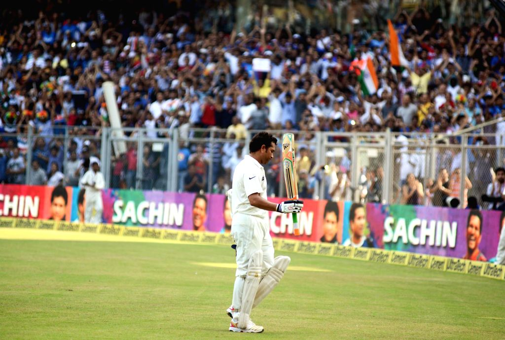 Indian cricketer Sachin Tendulkar walks back to pavilion during the 2nd day of the 2nd Test Match between India and West Indies at Wankhede Stadium in Mumbai on Nov.15, 2013. (Photo: Sandeep Mahankal/IANS) - Sachin Tendulkar