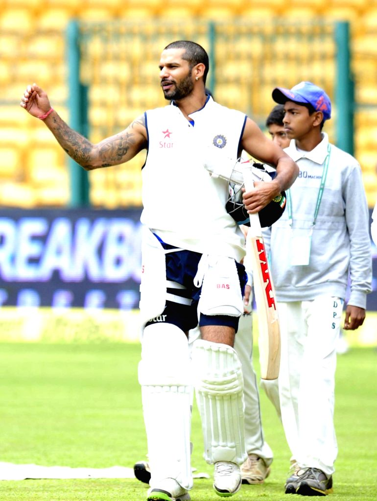 Indian cricketer Shikhar dhawan at M Chinnaswamy Stadium in Bengaluru, on Nov 18, 2015. The second test match between India and South Africa has been called off due to bad weather.