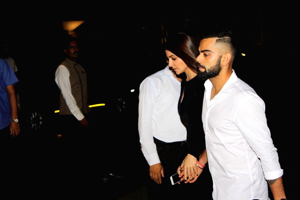 Indian cricketer Virat and actress Anushka Sharma arrived hand-in-hand for the Zaheer and Sagarika`s engagement ceremony, in Mumbai, on May 23, 2017. - Anushka Sharma