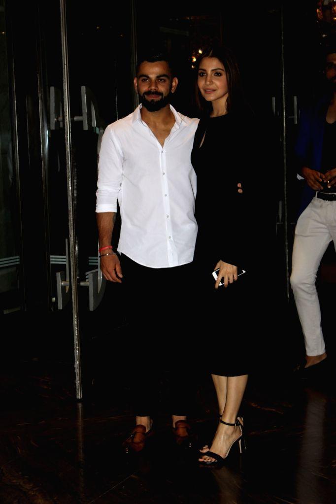 Indian cricketer Virat Kohli and actress Anushka Sharma during the engagement ceremony of Zaheer Khan and Sagarika Ghatge, in Mumbai, on May 23, 2017. - Anushka Sharma, Virat Kohli and Zaheer Khan
