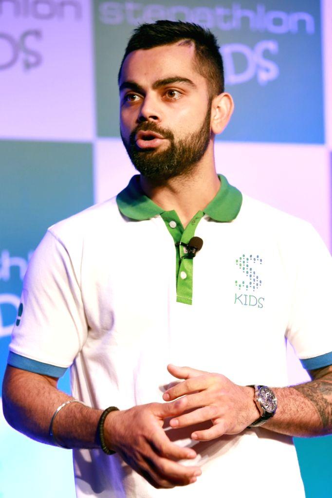 Indian Cricketer Virat Kohli during the launch of 'Stepathlon Kids', in New Delhi on June 27, 2016. - Cricketer Virat Kohli