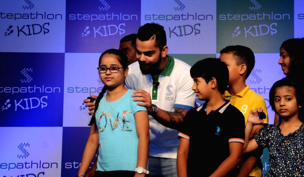 Indian Cricketer Virat Kohli during the launch of 'Stepathlon Kids', in New Delhi on June 28, 2016. - Cricketer Virat Kohli