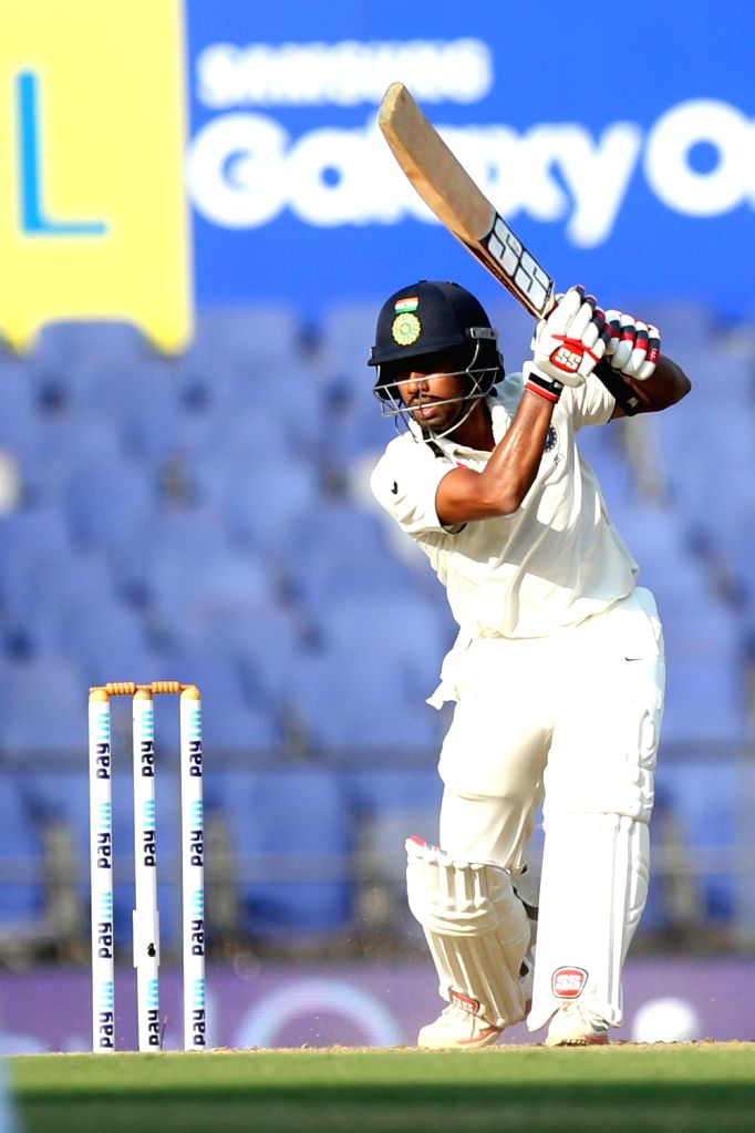 Indian cricketer Wriddhiman Saha in action during the Day-1 of the third test match between India and South Africa at Vidarbha Cricket Association Stadium in Nagpur  on Nov 25, 2015.