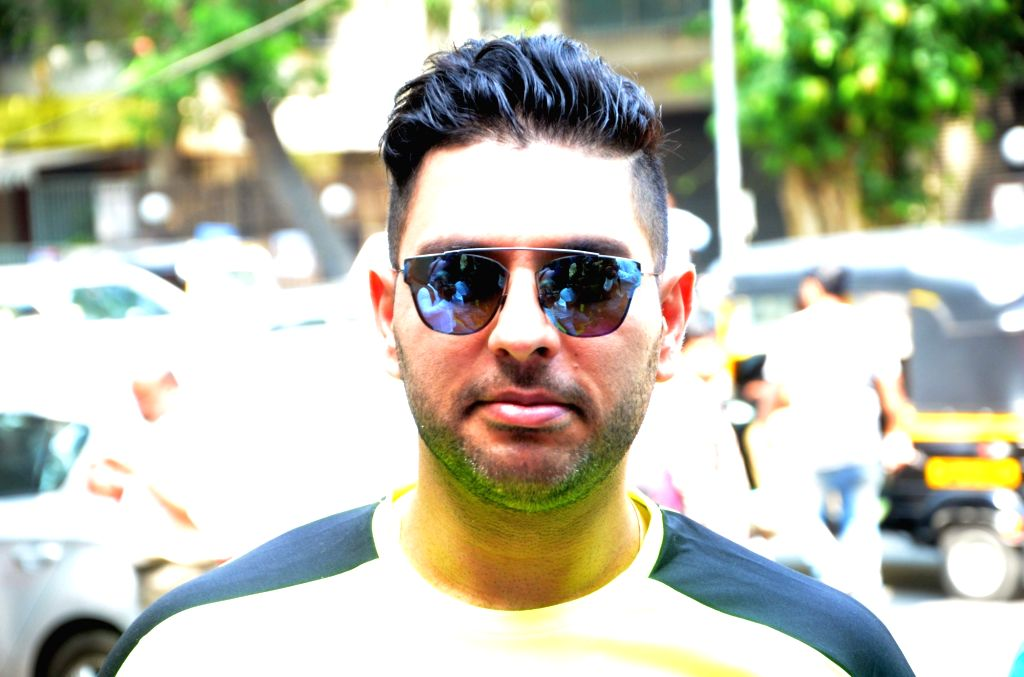 Indian cricketer Yuvraj Singh during a programme in Mumbai on April 21, 2016. - Yuvraj Singh