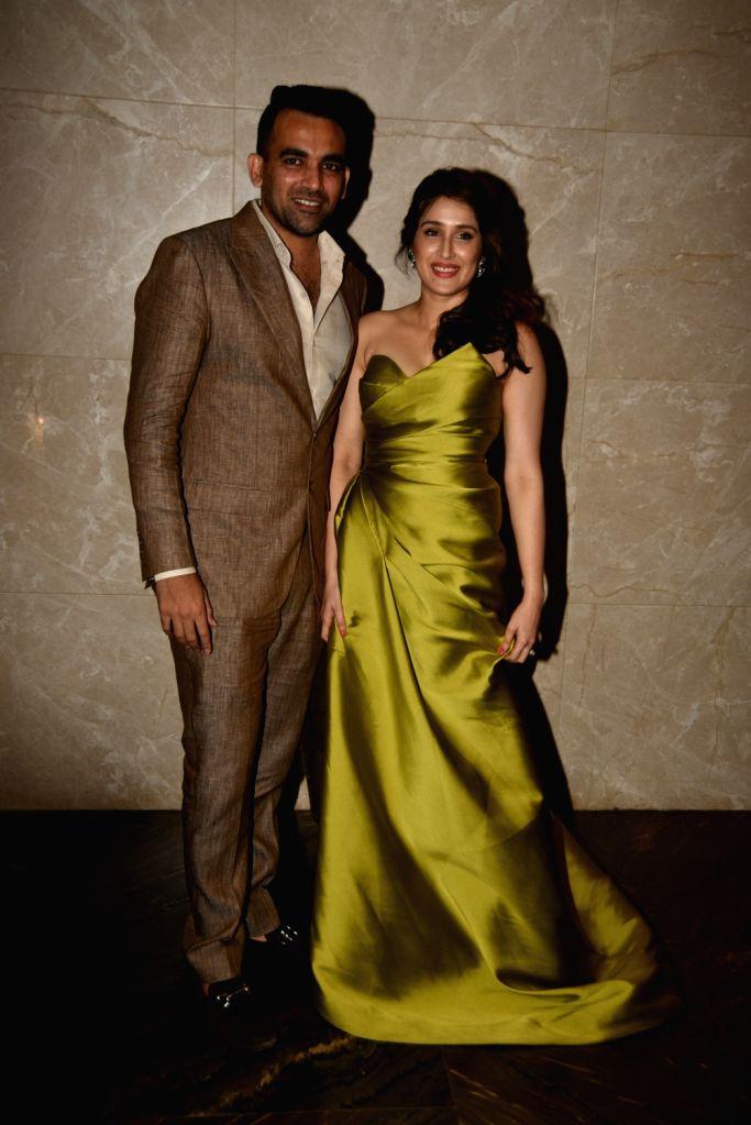 Indian cricketer Zaheer Khan and actress Sagarika Ghatge pose during their engagement ceremony, in Mumbai, on May 23, 2017. - Sagarika Ghatge and Zaheer Khan