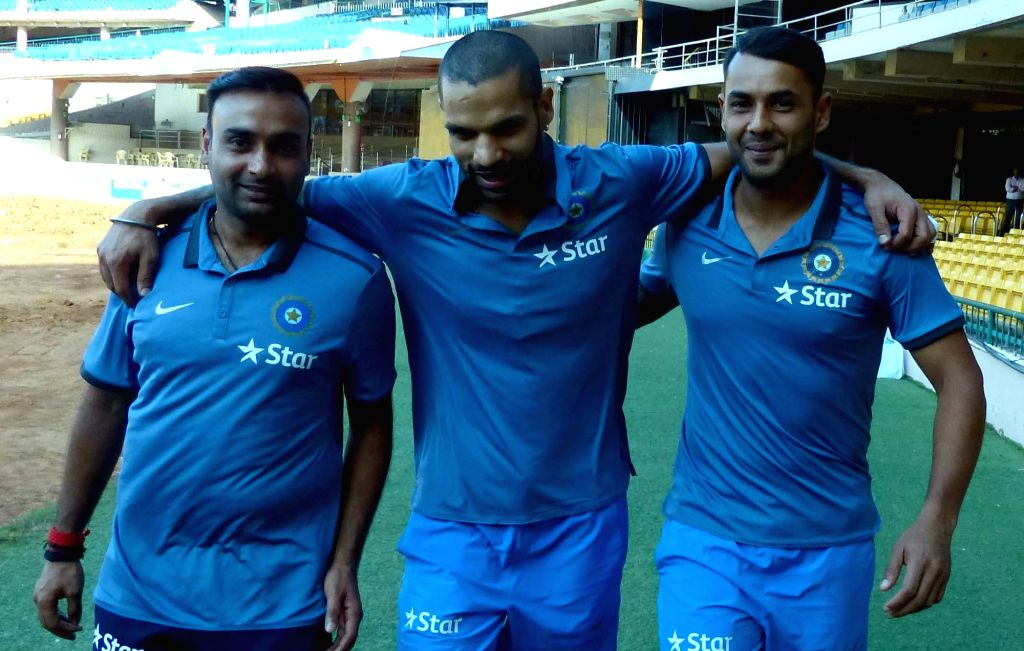 Indian cricketers Amit Mishra, Stuart Binny and Shikhar Dhawan during a preparatory camp ahead of West Indies tour at National Cricket Academy at Chinnaswamy Stadium, in Bengaluru on July ... - Shikhar Dhawan and Amit Mishra