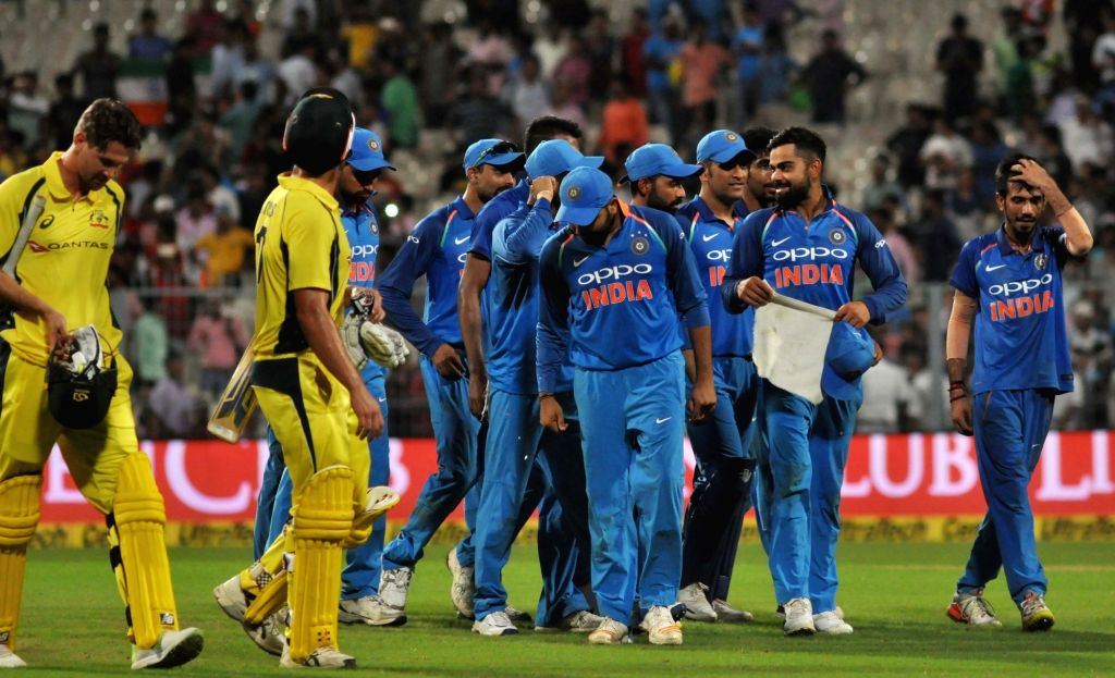 Indian cricketers celebrate after winning the second ODI cricket match against Australia at Eden Gardens in Kolkata on Sept 21, 2017.