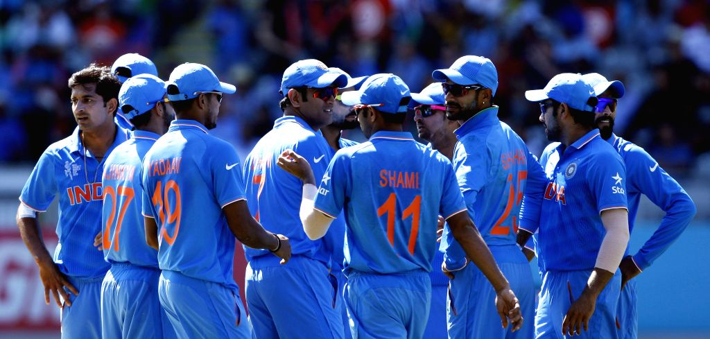 Indian cricketers celebrate fall of a wicket during an ICC World Cup 2015 match between India and Zimbabwe at the Eden Park in Auckland, New Zealand on March 14, 2015.