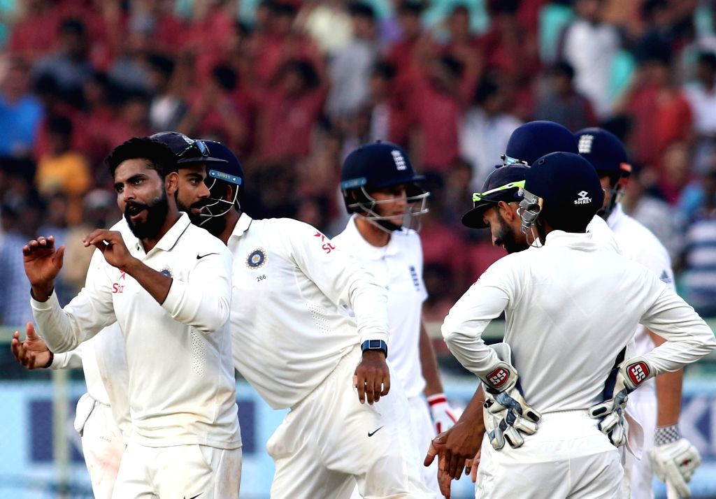 Indian cricketers celebrate fall of a wicket during the Day-4 of the second test cricket match between India and England at the Dr. YS Rajasekhara Reddy ACA-VDCA Cricket Stadium in ... - Rajasekhara Reddy A