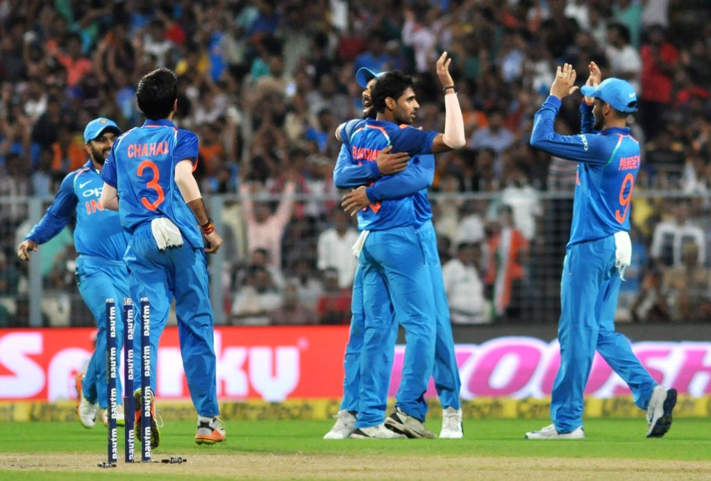 Indian cricketers celebrate fall of a wicket during the second ODI cricket match between India and Australia at Eden Gardens in Kolkata on Sept 21, 2017.