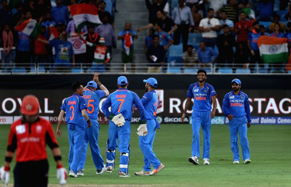 Indian cricketers celebrate fall of a wicket during the fourth match (Group A) of Asia Cup 2018 between Hong Kong and India at Dubai International Cricket Stadium on Sept 18, 2018.