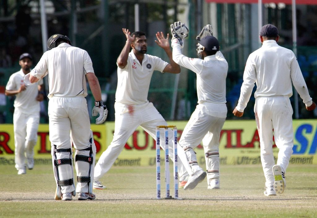 Indian cricketers celebrate fall of a wicket on Day 4 of the 1st Test match between India and New Zealand at Green Park in Kanpur on Sept 25, 2016.