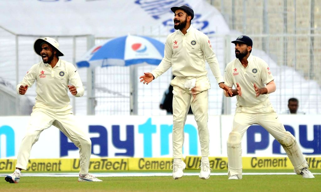 Indian cricketers celebrate fall of a wicket on Day 2 of the Second Test Match between India and New Zealand at Eden Gardens in Kolkata on Oct 1, 2016.
