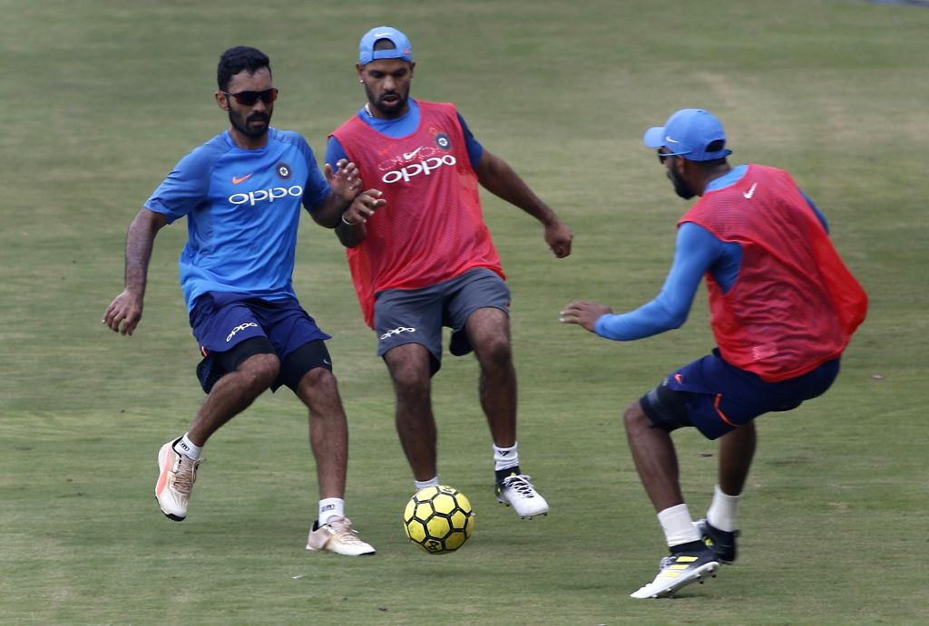 Indian cricketers Dinesh Karthik and Shikhar Dhawan during a practice session ahead of the 3rd T20 match against Australia at the Rajiv Gandhi International Cricket Stadium in Hyderabad on ... - Shikhar Dhawan