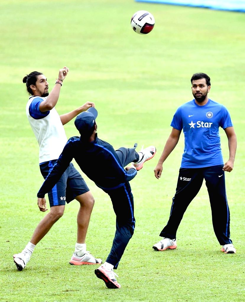 Indian cricketers Ishant Sharma and Rohit Sharma during a practice session ahead of the 2nd test match against South Africa at Chinnaswamy Stadium, in Bengaluru on Nov. 13, 2015. - Ishant Sharma and Rohit Sharma