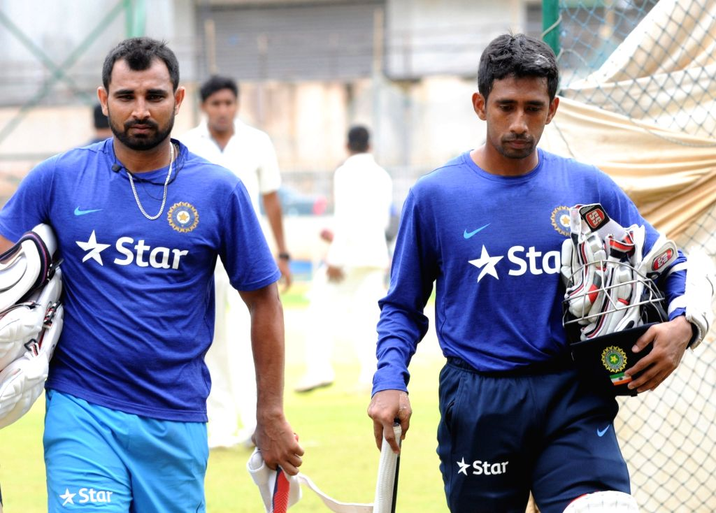 Indian cricketers Mohammed Shami and Wriddhiman Saha during a preparatory camp ahead of  West Indies tour at National Cricket Academy at Chinnaswamy Stadium, in Bengaluru on July 1, 2016.