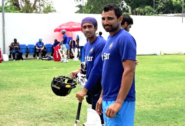 Indian cricketers Mohammed Shami and Wriddhiman Saha during a practice session at Kingston, Jamaica July 31, 2016.