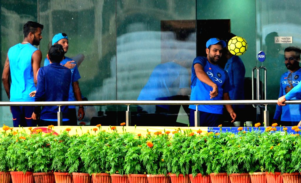 Indian cricketers play with football after practice session was cancelled due to rains at the JSCA Stadium in Ranchi on Oct 6, 2017.