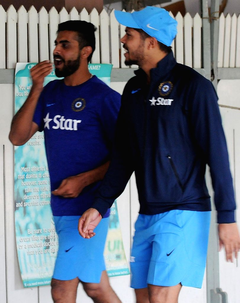 Indian cricketers Ravindra Jadeja and Umesh Yadav during the team preparatory camp before its tour to West Indies at Chinnaswamy Stadium, in Bengaluru on June 29, 2016. - Ravindra Jadeja and Umesh Yadav