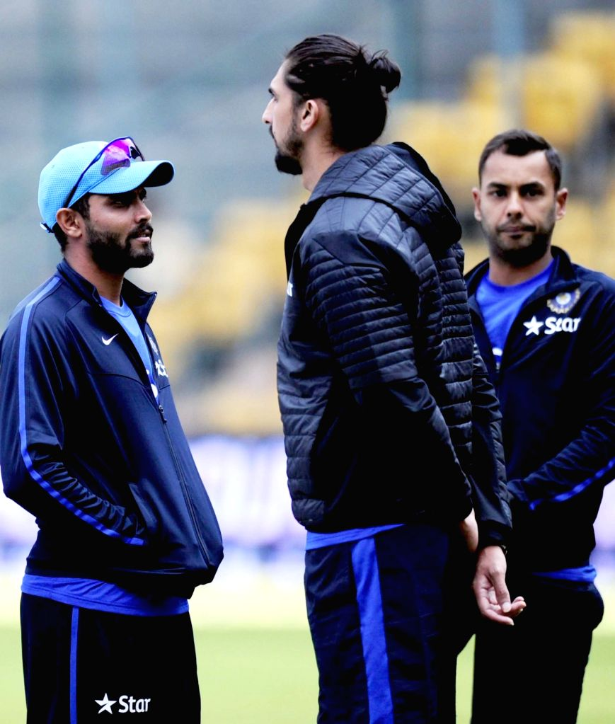 Indian cricketers Ravindra Jadeja, Ishant Sharma and Stuart Binny at M Chinnaswamy Stadium in Bengaluru, on Nov 18, 2015. The second test match between India and South Africa has been ... - Ravindra Jadeja and Ishant Sharma