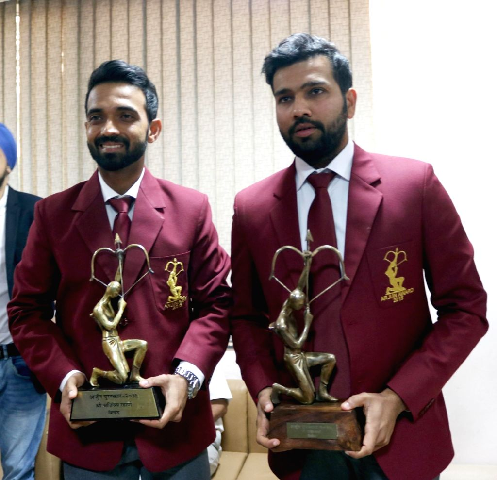 Indian cricketers Rohit Sharma and Ajinkya Rahane during a programme organised to felicitate them with Arjuna Award in New Delhi on Sept 16, 2016. - Rohit Sharma
