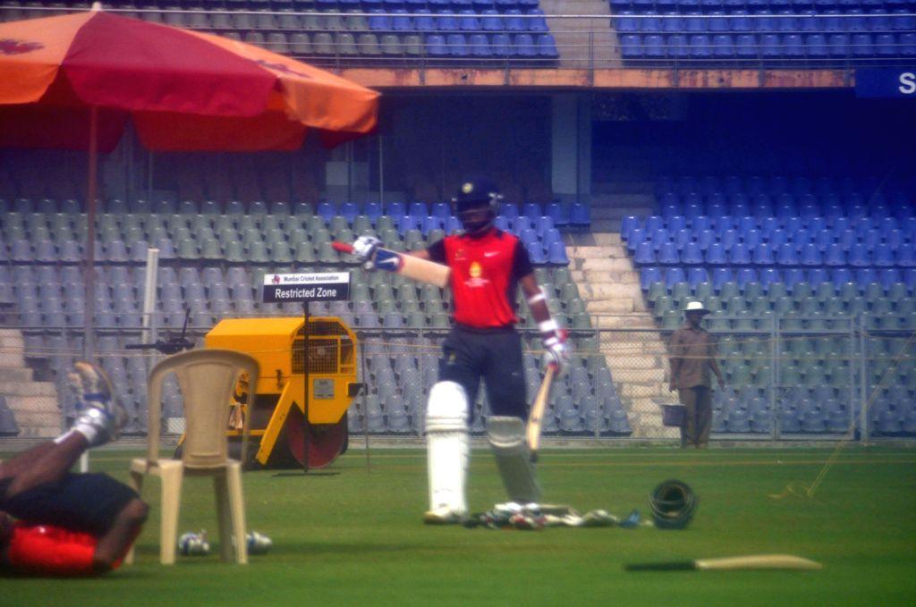 Indian cricketers Sachin Tendulkar, Rohit Sharma, Ajinkya Rahane, Abhishek Nayar and others practising at Wankhede Stadium in preparation of Irani Trophy Cricket match in Mumbai on Feb. 4. (Photo: ... - Sachin Tendulkar and Rohit Sharma