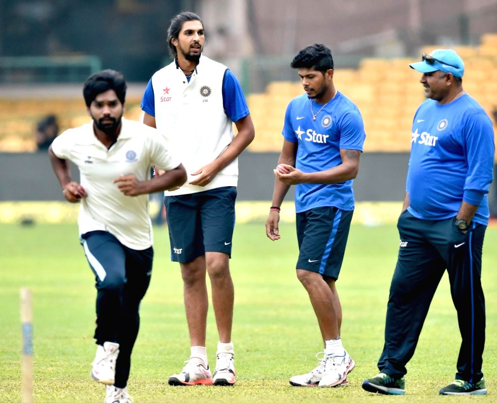 Indian cricketers Umesh Yadav and Ishant Sharma during a practice session ahead of the 2nd test match against South Africa at Chinnaswamy Stadium, in Bengaluru on Nov. 13, 2015. - Umesh Yadav and Ishant Sharma
