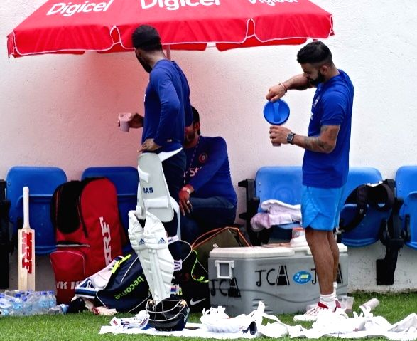 Indian cricketers Virat Kohli and Lokesh Rahul during a practice session at Kingston, Jamaica July 31, 2016. - Virat Kohli and Lokesh Rahul