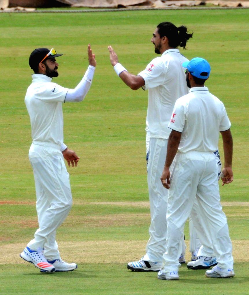 Indian cricketers Virat Kohli, Ishant Sharma and Ajinkya Rahane during a practice match on the fifth day of the preparatory camp a head of West Indies tour, in Bengaluru on July 3, 2016. - Virat Kohli and Ishant Sharma