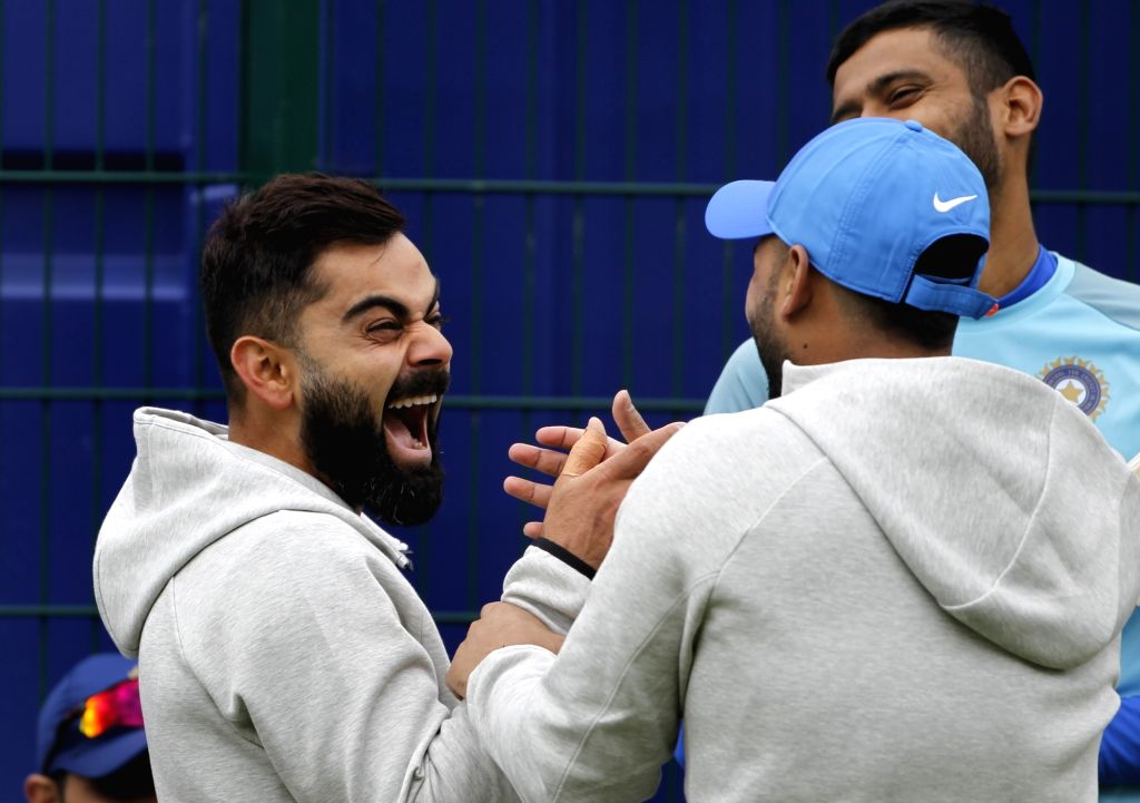 Indian cricketers Virat Kohli, Rishabh Pant and Khaleel Ahmed during a practice session ahead of the World Cup 2019 match against Pakistan in Manchester, England on June 15, 2019. - Virat Kohli