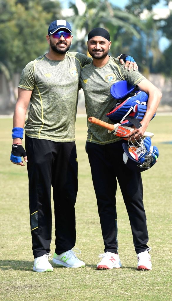 Indian cricketers Yuvraj Singh and Harbhajan Singh during a practice session ahead of Syed Mushtaq Ali T20 tournament, in Kolkata on Jan 20, 2018. - Yuvraj Singh and Harbhajan Singh