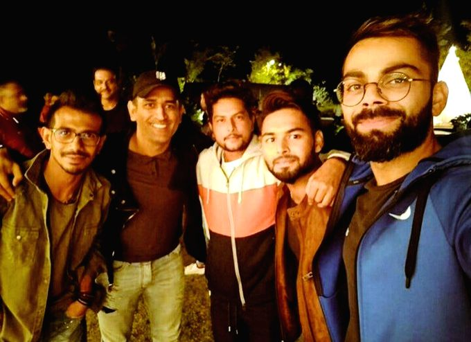 Indian cricketers Yuzvendra Chahal, Kuldeep Yadav, Rishab Pant and Virat Kohli with MS Dhoni who hosted a dinner for his teammates in Ranchi. - MS Dhoni, Kuldeep Yadav and Virat Kohli