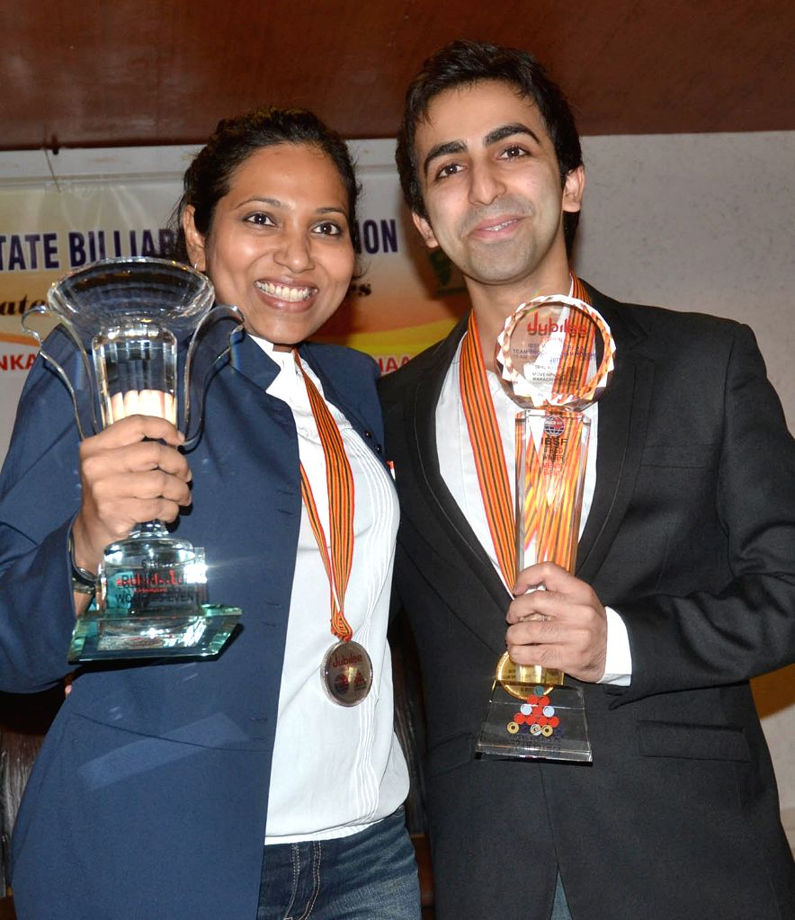 Indian cueists Pankaj Advani, who won the 13th world snooker championship and Vidya Pillai, who bagged silver medal in the championship, which was held in Karachi, being felicitated on ...