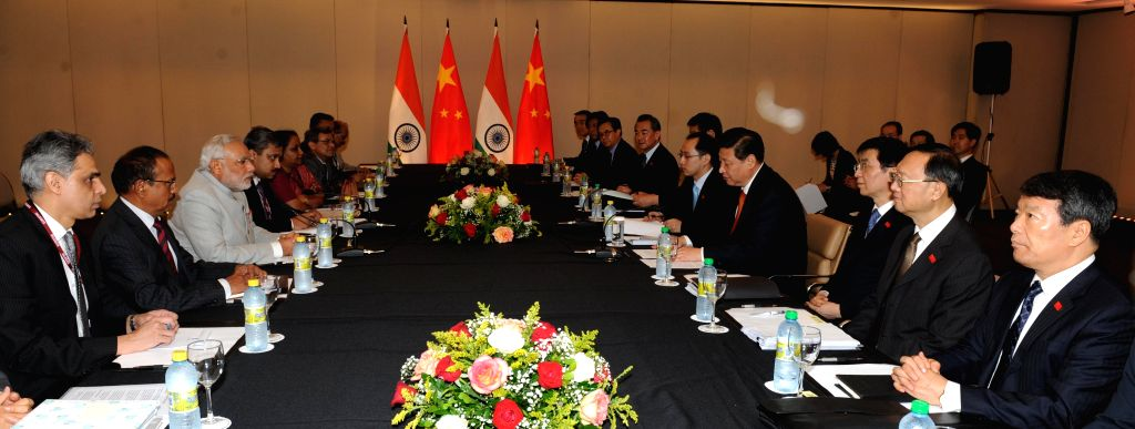Indian delegation led by Prime Minister Narendra Modi meets Chinese delegation led by President of the People's Republic of China Xi Jinping on the sidelines of 6th BRICS Summit in Fortaliza, Brazil . - Narendra Modi