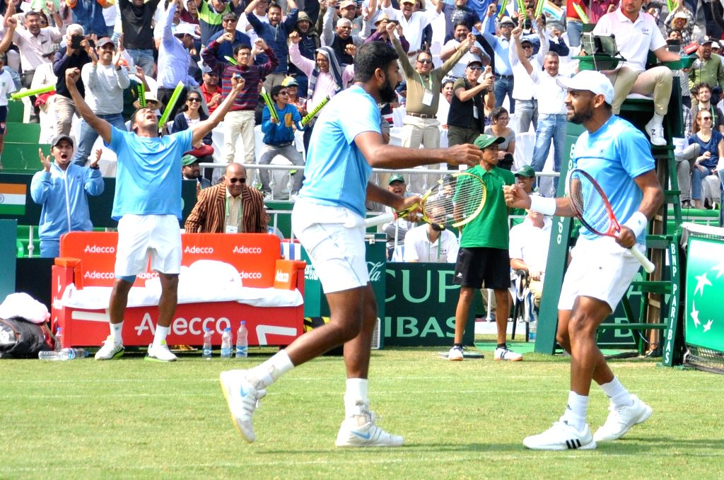 Indian doubles pair of Rohan Bopanna and c celebrate after beating Italians Matteo Berrettini and Simone Bolelli at the Davis Cup World Group doubles rubber in Kolkata on Feb. 2, 2019. - Rohan Bopanna