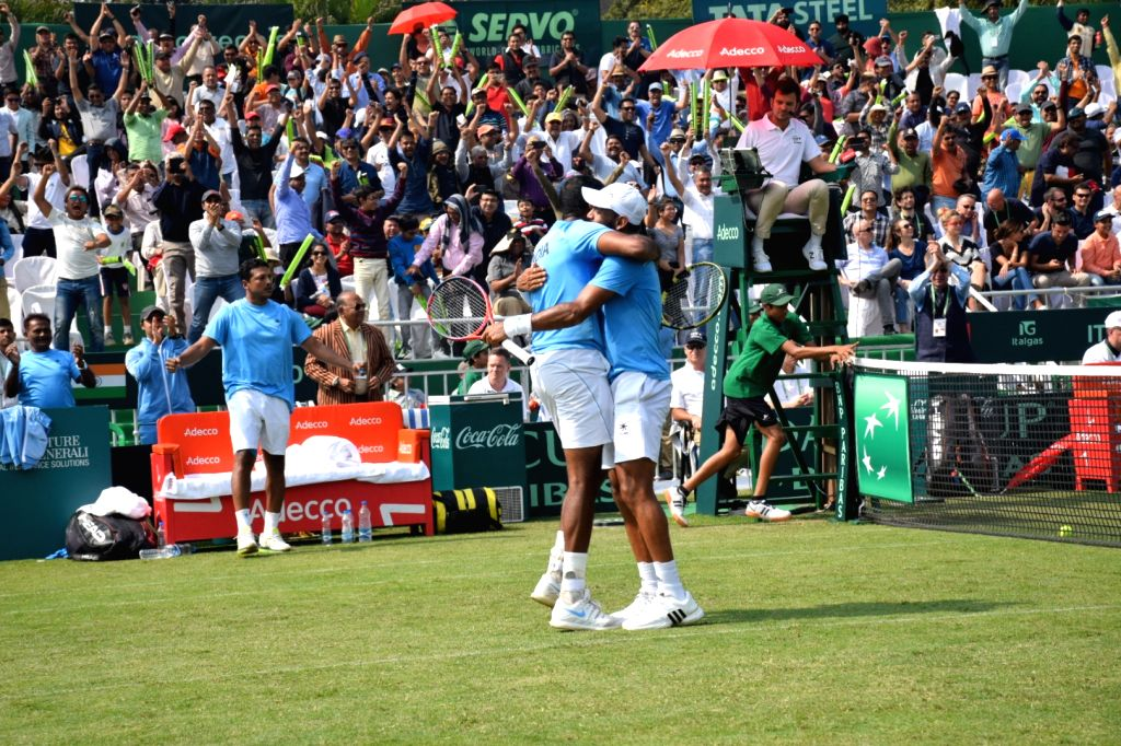 Indian doubles pair of Rohan Bopanna and Divij Sharan celebrates after beating Italians Matteo Berrettini and Simone Bolelli at the Davis Cup World Group qualifier tie in Kolkata on Feb. 2, ... - Rohan Bopanna