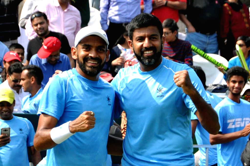 Indian doubles pair of Rohan Bopanna and Divij Sharan celebrate after beating Italians Matteo Berrettini and Simone Bolelli at the Davis Cup World Group doubles rubber in Kolkata on Feb. 2, ... - Rohan Bopanna