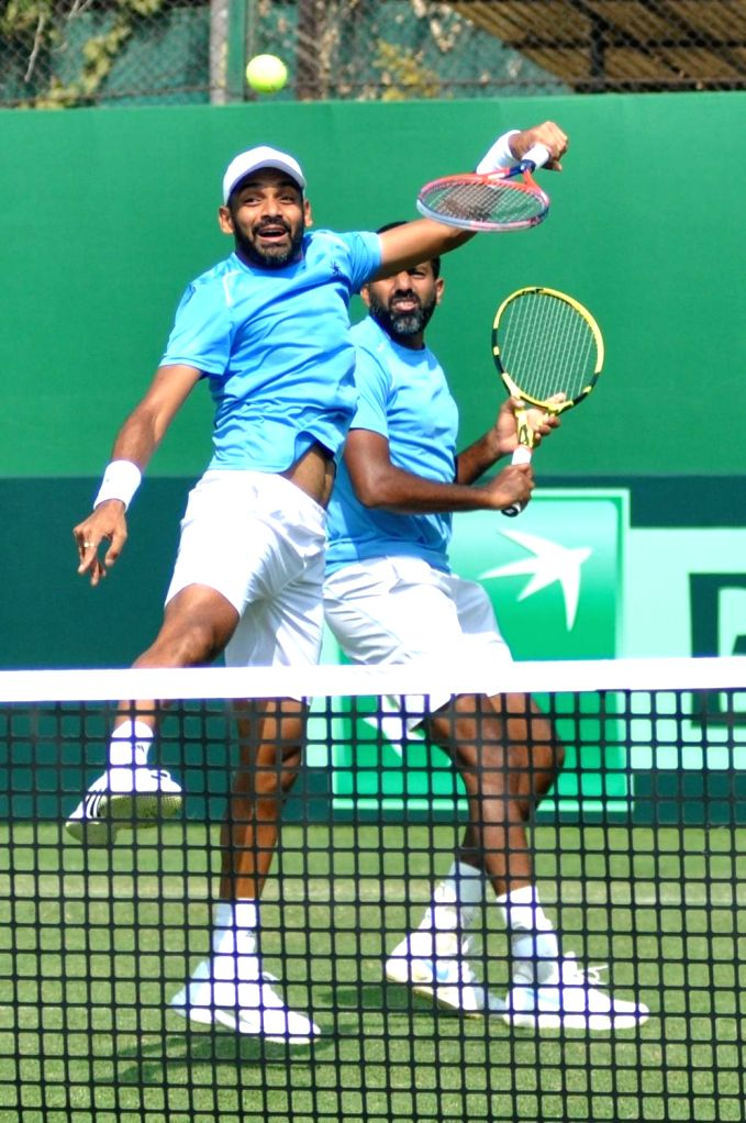 Indian doubles pair of Rohan Bopanna and Divij Sharan in action against Italy's Matteo Berrettini and Simone Bolelli at the Davis Cup World Group doubles rubber in Kolkata on Feb. 2, 2019. - Rohan Bopanna