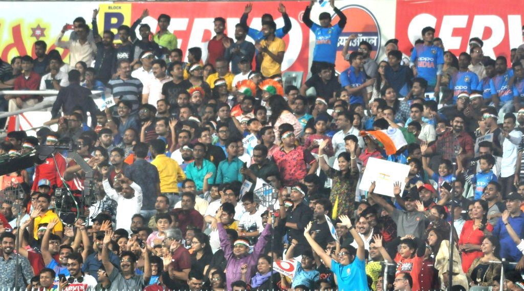 Indian fans cheer during the first T20 International match between Indian and West Indies at the Eden Gardens in Kolkata, on Nov 4, 2018.